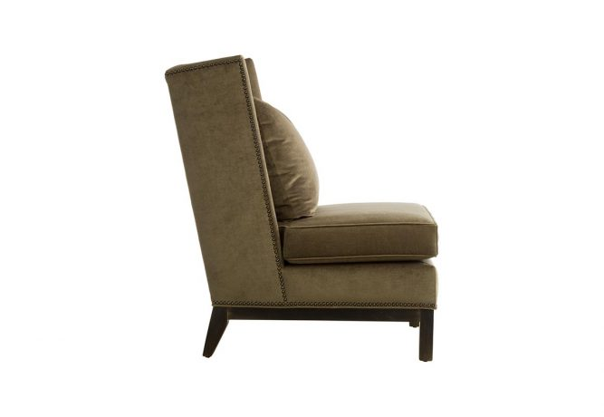 Side view of a Vogel by Chervin's 11135 Slipper Wing Chair featuring emerald green suede fabric and comes standard with metal nail head trim
