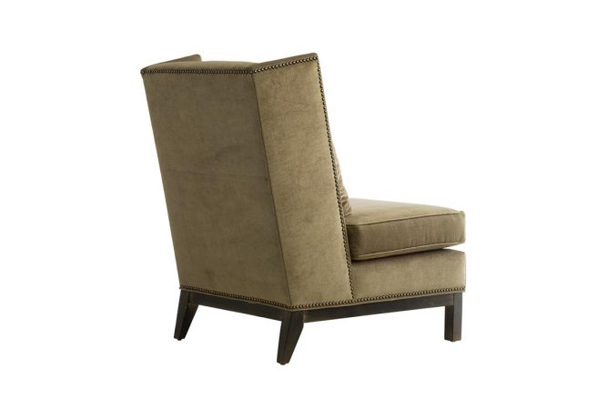 Rear view of a beautiful slipper wing chair in a green suede fabric with espresso legs