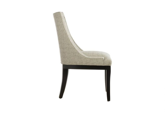 Side view of the 11181 dining chair by Vogel made in Toronto, ON and allows you to choose you fabric and wood finish.