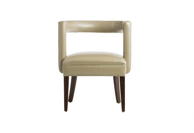 Beautiful contemporary accent chair featuring beige leather with nail head trims on the back and an espresso wood finish on the flared legs.