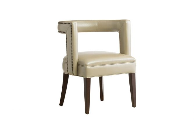 The 11182 transitional Accent Chair featuring a beige leather with nail head trim, espresso wood finish and flared legs and is manufactured in Toronto