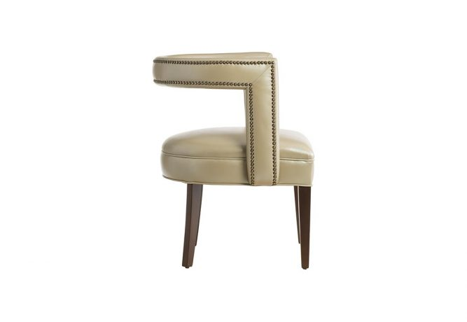 Side view of the 11182 Vogel chair in beige leather, but available in over 300 different fabrics, and showcased with nailhead trims and espresso wood finish.