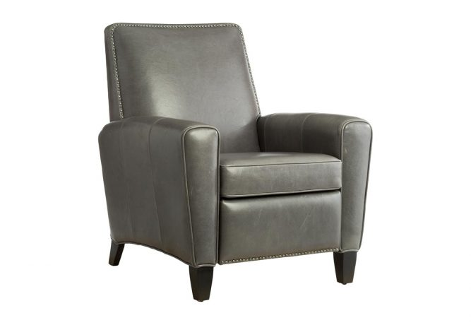 leather reclining chair featuring nail head trim