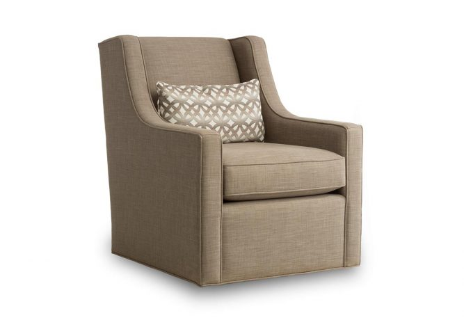 brown swivel chair with fancy back pillow