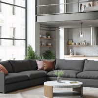 studio apartment with large windows and extra large charcoal sectional