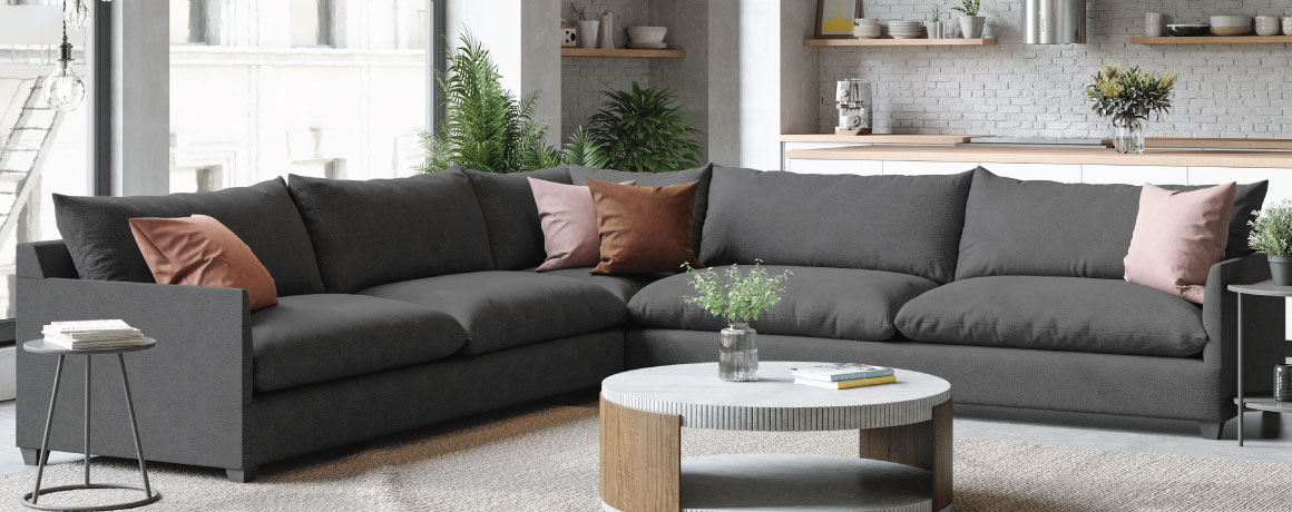 modern grey lounge sectional in a city apartment
